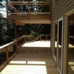 Cedar deck and balcony with waterproof membrane for lower exterior living room