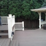 Composite deck and custom wood rails