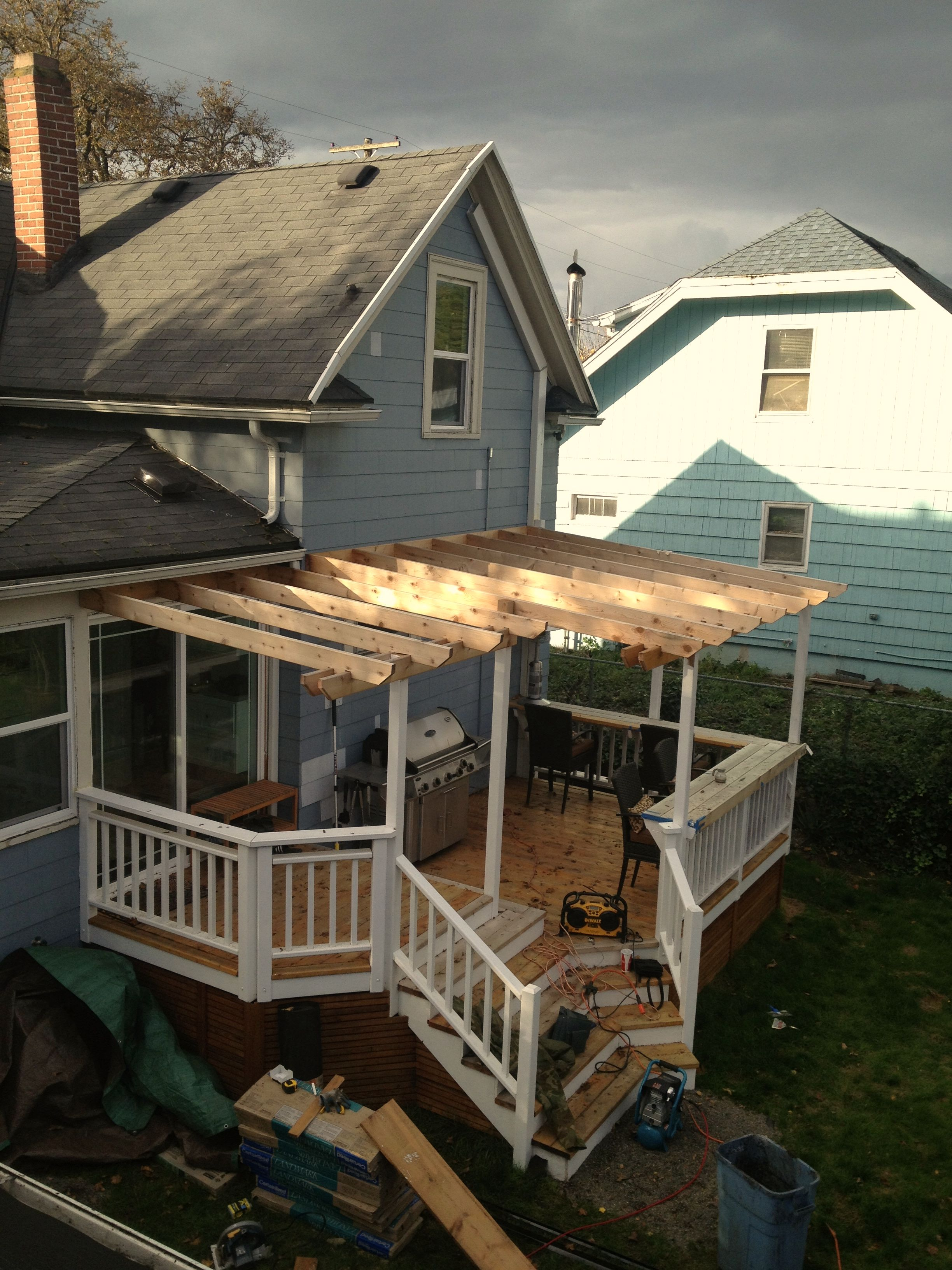 Cedar deck trellis steps rails w built in bar for Deck trellis