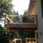 Cedar deck balcony, picket rails and rain protection underneath