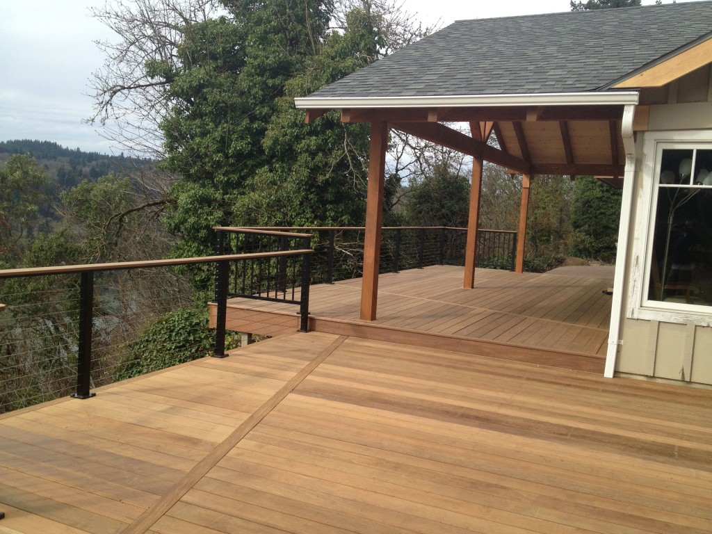 Finished ironwood decks new overhang buildstrong for Balcony overhang